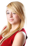 Blond teen girl winking Royalty Free Stock Photography