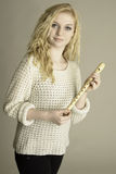 Blond teen holding wooden recorder Stock Images