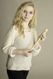 Blond teen holding wooden recorder. Blond teen holding a wooden recorder stock images