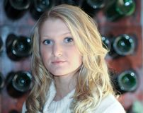 Blond Teen wine rack Royalty Free Stock Photos
