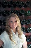 Blond Teen wine rack Stock Photography