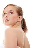 Blond teen woman in bathrobe royalty free stock image