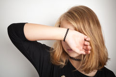 Blond teenage girl in black modern tattoo chokers Stock Photos