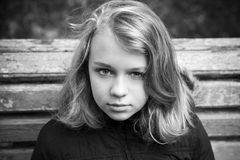 Blond teenage girl in black, monochrome portrait Stock Image