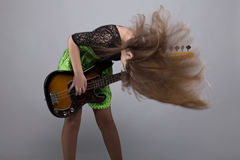 Blond teenage girl with guitar, shaked head Royalty Free Stock Image