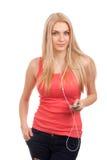 Blond teenage girl listen music Stock Images