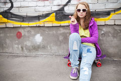 Blond teenage girl with lollipop, urban portrait Royalty Free Stock Image