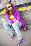 Blond teenage girl with lollipop, urban portrait Stock Photos