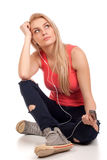 Blond teenage girl sitting and listen music Royalty Free Stock Photos