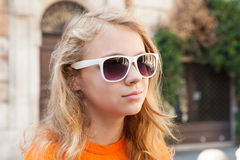 Blond teenage girl in sunglasses, closeup photo Royalty Free Stock Image