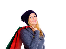 Blond teenager holding shopping bags over Royalty Free Stock Photos