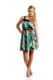 Blond teenager posing in a summer dress Stock Photos