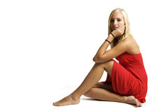 Blond teenager sitting and waiting Royalty Free Stock Image