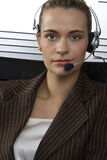 Blond Telesales. Young attractive blond call center agent talking on the headset in a modern office setting Royalty Free Stock Photo