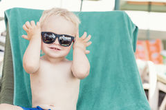Blond toddler boy wearing sunglasses Stock Photography