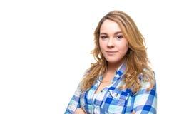 Blond tonåringstudent med den blåa plädskjortan Arkivfoton