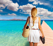 Blond tourist girl in Alcudia beach of Mallorca. Photomount Stock Images