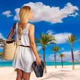 Blond tourist girl in Alcudia beach of Mallorca Royalty Free Stock Photos