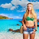 Blond tourist girl in Cala Agulla beach of Mallorca Stock Photos