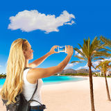 Blond tourist girl in Cala Agulla beach of Mallorca Stock Photo