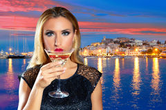 Blond tourist girl drinking vermout cup at Ibiza Stock Photos