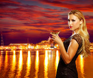 Blond tourist girl drinking vermout cup at Ibiza Royalty Free Stock Photo