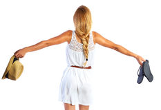 Blond tourist girl with flip flop shoes white dress Stock Photo