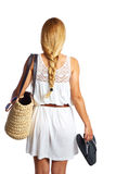 Blond tourist girl with flip flop shoes white dress Royalty Free Stock Photo