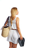 Blond tourist girl with flip flop shoes white dress Stock Photography