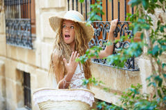Blond tourist girl in mediterranean old town Stock Image