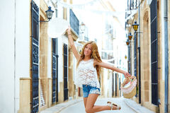 Blond tourist girl in mediterranean old town Royalty Free Stock Image