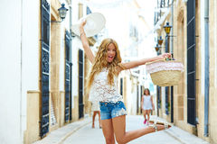 Blond tourist girl in mediterranean old town Stock Image