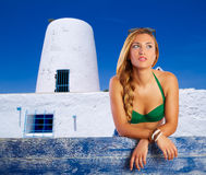 Blond tourist girl in a mill at Formentera Stock Photos