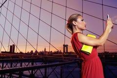 Blond tourist girl selfie photo in Brooklyn Bridge Stock Image