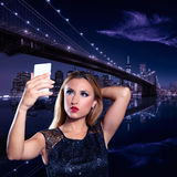Blond tourist girl selfie photo in New York at night Stock Photos