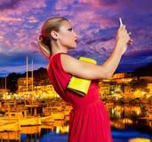 Blond tourist girl selfie photo in Soller port Mallorca Stock Images