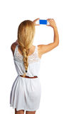 Blond tourist girl taking photos with smartphone Royalty Free Stock Photos