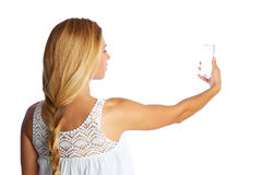 Blond tourist girl taking photos with smartphone Royalty Free Stock Image
