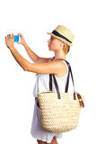 Blond tourist girl taking photos with smartphone Stock Photos
