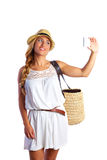 Blond tourist girl taking photos with smartphone Royalty Free Stock Images