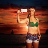 Blond tourist girl taking selfie photo Benirras Ibiza Royalty Free Stock Photo