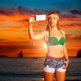 Blond tourist girl taking selfie photo Benirras Ibiza Royalty Free Stock Photography
