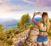Blond tourist in Mallorca taking photos Royalty Free Stock Image