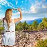 Blond tourist in Mallorca taking photos Stock Photo