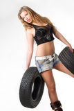 Blond with tyres Royalty Free Stock Image
