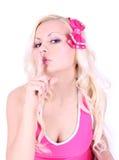 Blond ung flicka med fingret på henne kanter fotografering för bildbyråer
