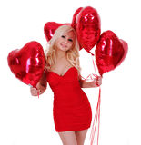 Blond ung kvinna med ballonger för valentindag Arkivfoto