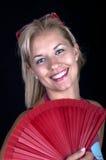 blond ventilatorflicka Fotografering för Bildbyråer