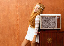 Blond vintage 70s kid girl with retro wood tv Stock Photo