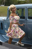Blond with vintage car Royalty Free Stock Images